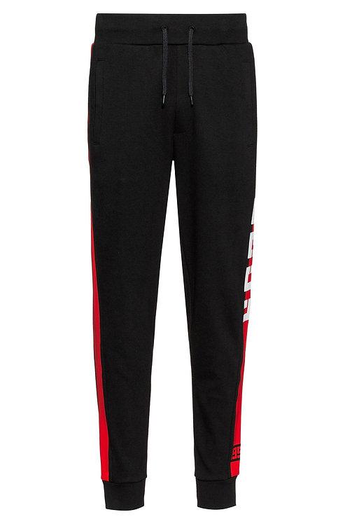 Pantalon HUGO en jersey interlock, avec rayure contrastante sur le côté