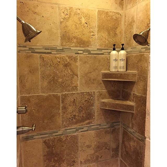 Double the shower heads, double the fun! Here's a staggered brick pattern of Travertine tile with du