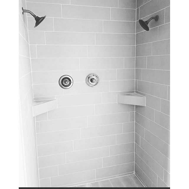 Who says you can't enjoy an investment_ Check out this custom shower with staggered whitewashed-bric