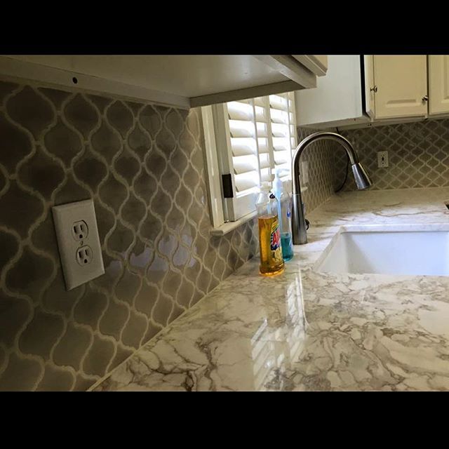 Check out this antique tile backsplash with Italian granite countertops & farm sink