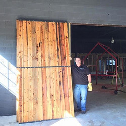 The bigger the sliding barn door the better! Call me to add a custom industrial look to your home or