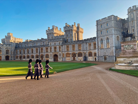 Soldiers marching in the Quadrangle with the statue of Charles II and the Queen's apartments in the background