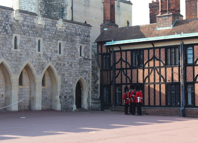 Guards inspecting each other inside the lower ward of the castle.