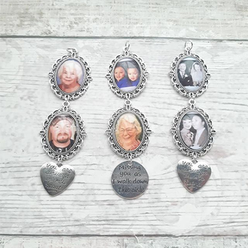 Three charms sit open with various photos of loved ones in them and a metal plate hanging from each with three different sayings engraved into them. The charms sit on a light wood background.