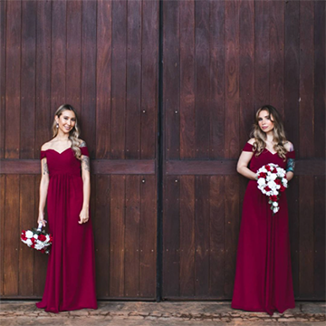 A Caucasian woman with blonde hair in a maroon dress stands in two poses against a dark wood background: The left pose holds her white and maroon bouquet down at her side and the right-hand side holds the bouquet in front of her belly.
