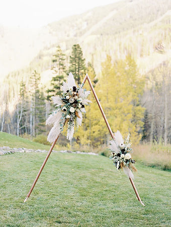 creative wedding arch, handmade with copper tubing, pampas grass, protea, onsite at Beano's Cabin in Beaver Creek, Colorado by Vintage Magnolia.