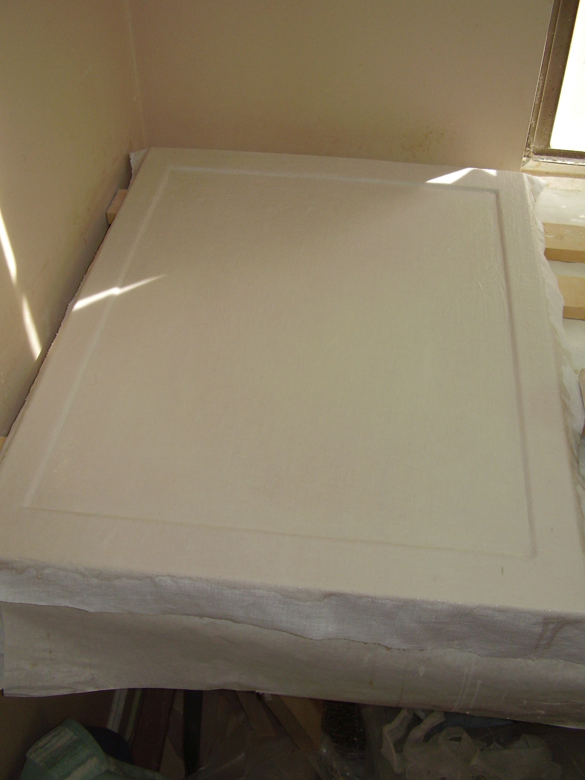 Board primed with linen