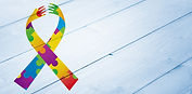 Autism awareness ribbon against bleached
