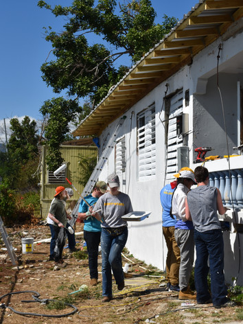 The Disaster Relief team paints a house in Puerto Rico