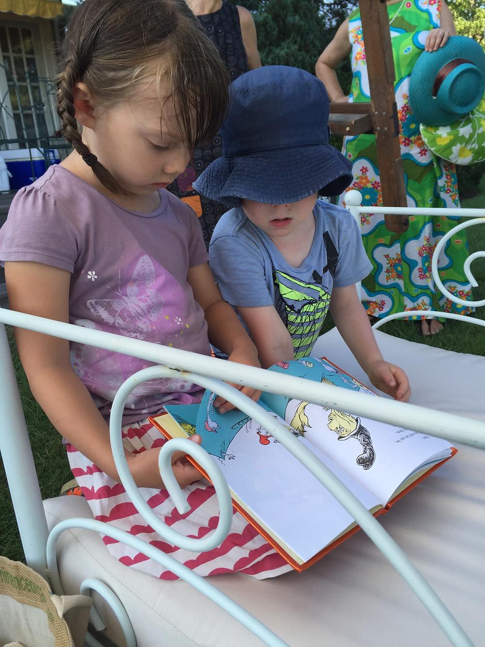 E V Starkey's son reading a book