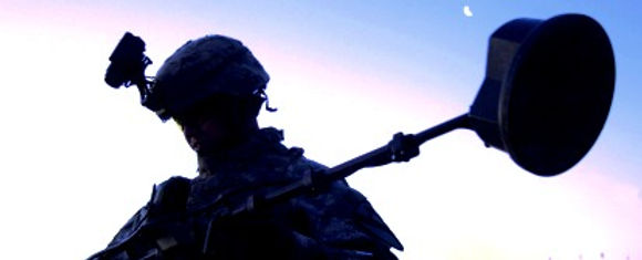 header-soldier-holding-equipment-at-suns
