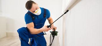 bigstock-Worker-Spraying-Pesticide-On-W-
