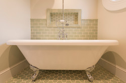 clawfoot bathtub handmade tile