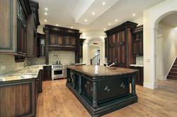 Luxury Kitchen With Dark Cabinetry