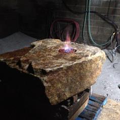 Rustic boulder fire feature