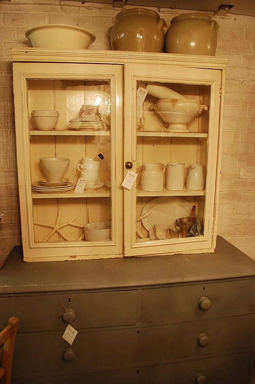 Glass-fronted wall cupboard