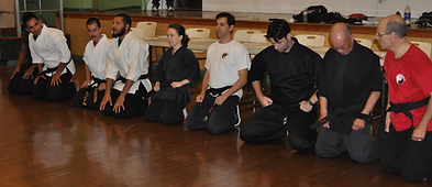 Bowing with the judges after my black belt exam