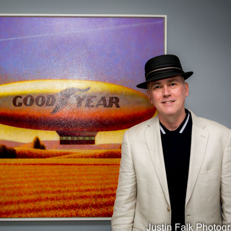 Peter Drake with his painting
