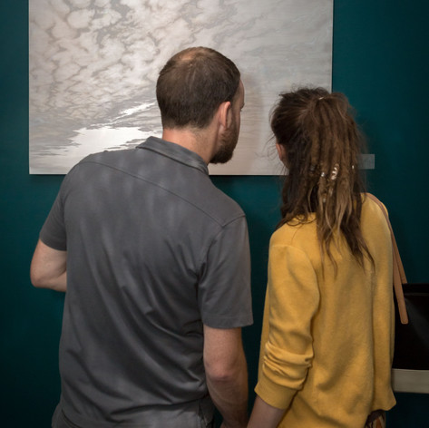 People observing Lisa Lebofsky's painting