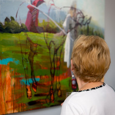 People observing Caitlin Hurd's painting
