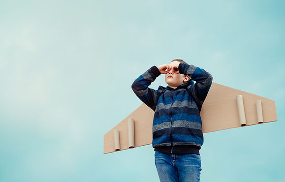 child-playing-outdoors-paper-wings.jpg