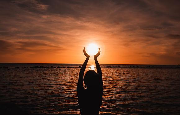 woman-beach-with-her-hands-raised.jpg
