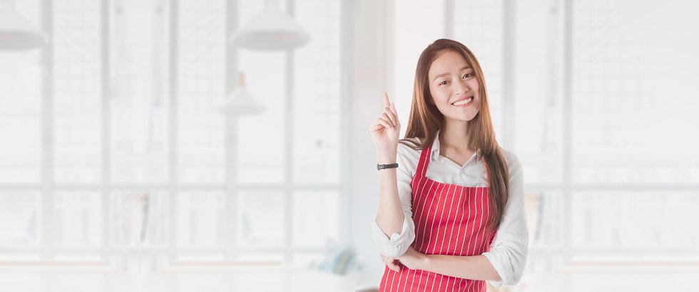 portrait-smiling-beautiful-asian-woman-wear-apron-hand-pointing.jpg