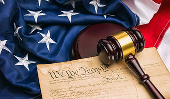 American Constitution - We the people with USA Flag and judge gavel.jpg