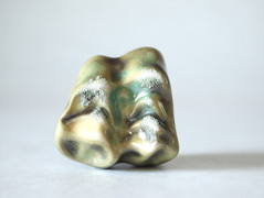 High-fired, glazed and slip-casted porcelain.