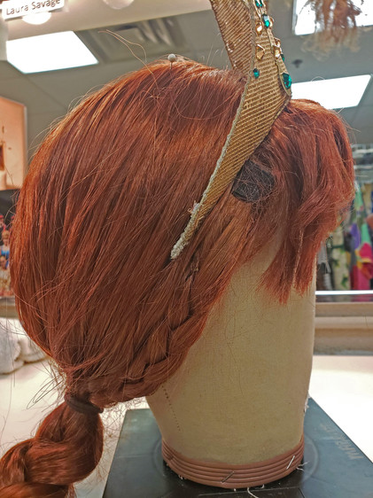An additional braided piece was attached to the wig to cover the actress's ears.