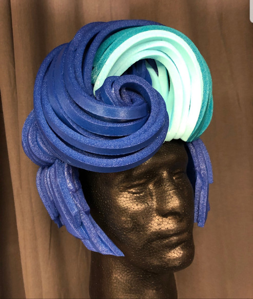 Foam wigs were constructed by etsy seller, Allemaal Tejater.