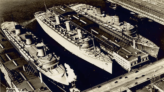 RMS Queen Mary RMS Queen Elizabeth SS Normandie docked together in NYC