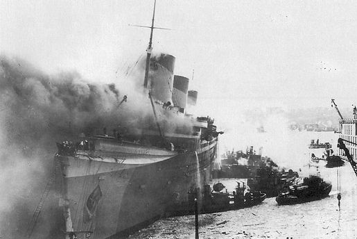 SS Normandie on fire Hudson River WWII refit troop transport