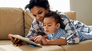 AS_mom_and_child_tech-iStock-583700688_1