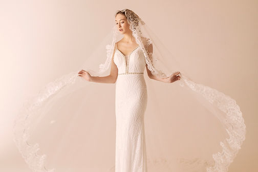 Bridal Editorial Fashion image of a white wedding dress and luxury weddin veil