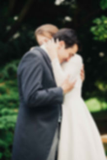 a portrait of a newly married couple embracing on their wedding day
