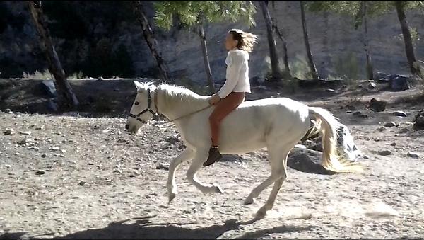 Kim riding without saddle