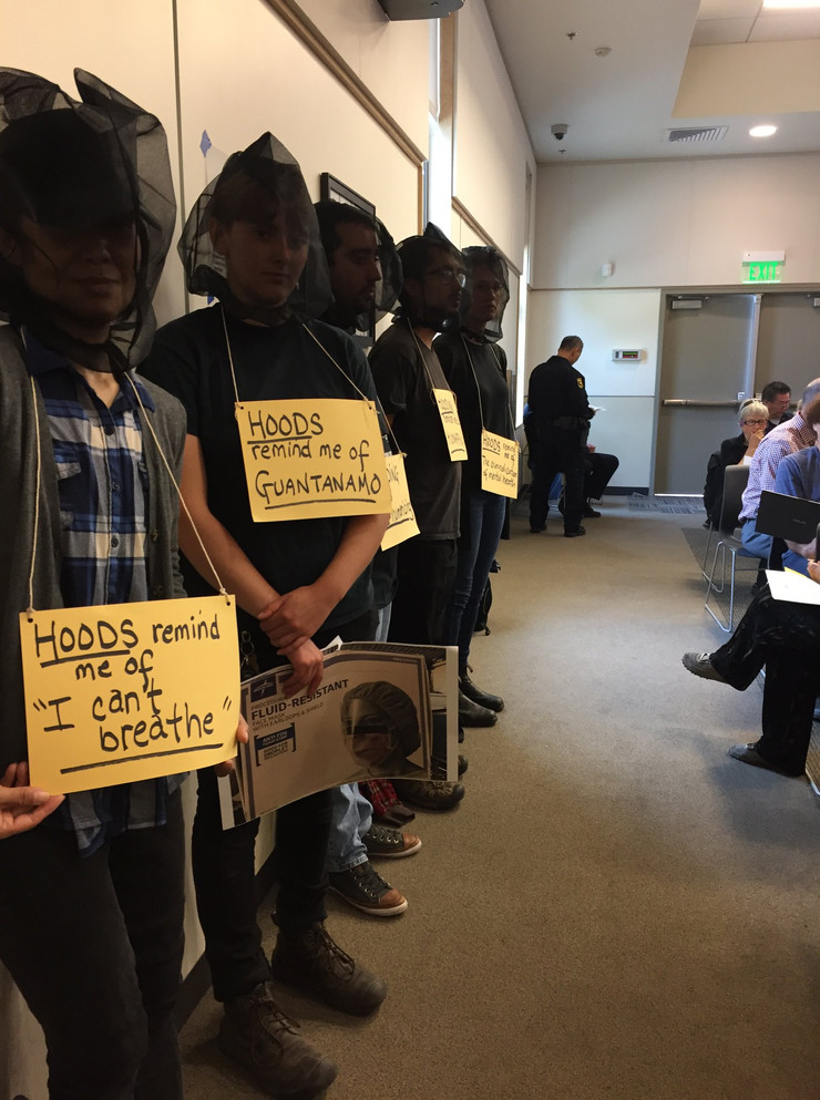 Copwatchers Wear Spit Hoods During City Council Meeting to Protest their use by the Berkeley Police