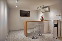 Air Conditioned Common Area with TV, Barchair and Bartable.