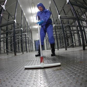 worker-cleaning-in-blue