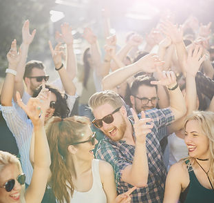 Group of people dancing at outdoor party