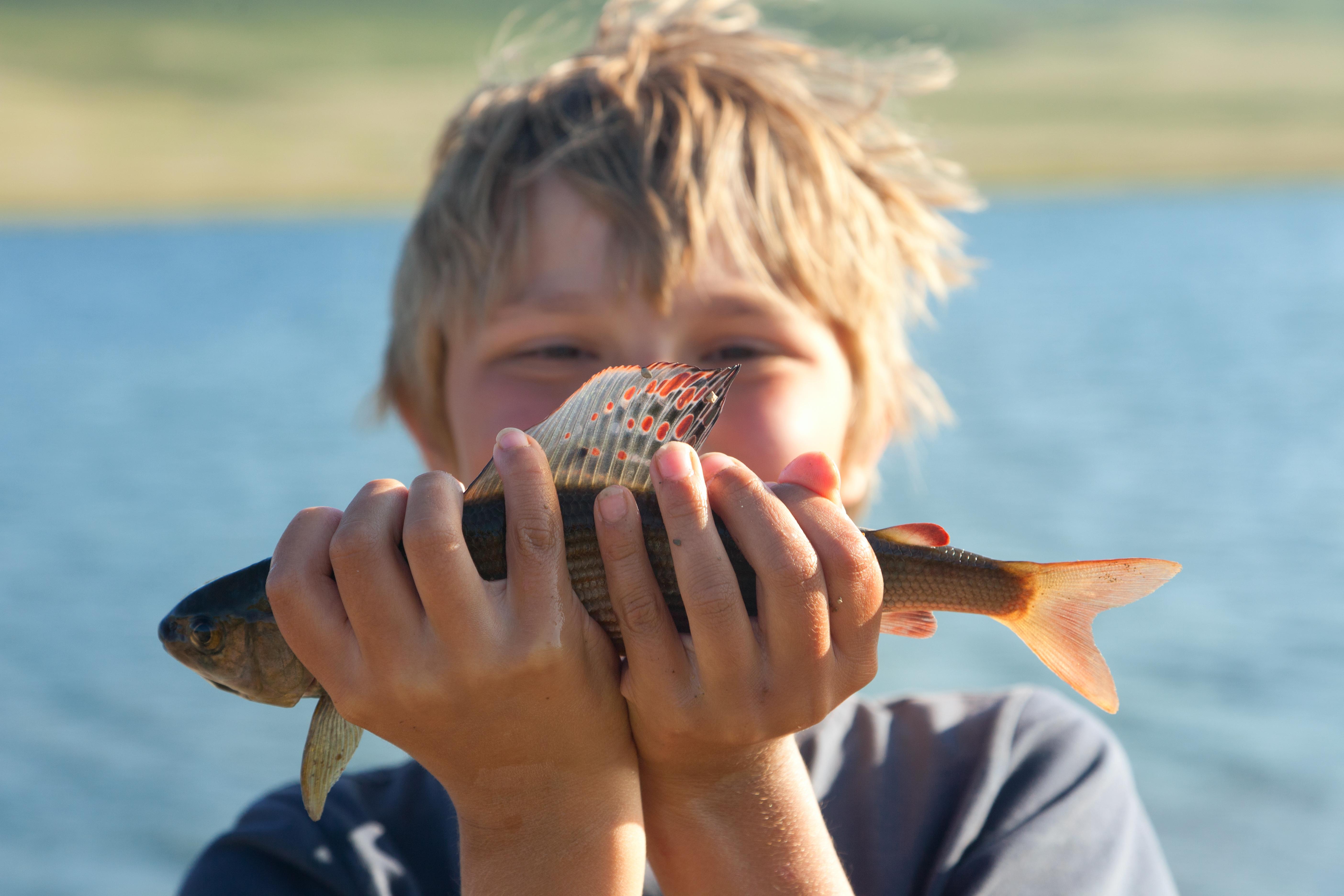 Shutter kid holding fish.jpg