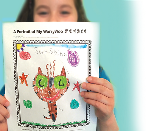 Girl holding WorryWoo drawing