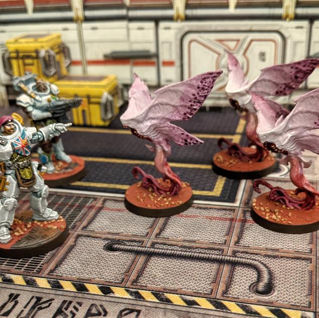 Xenomoths vs White Squad.jpg