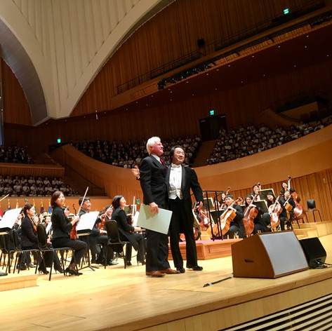 Seoul, South Korea, 2017 Ian Krouse with Maestro Jong Hoon Bae after performance of the First Movement of Ian's Fifth Symphony.