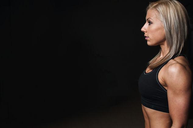 Canva - Woman Wearing Black Sports Bra.j