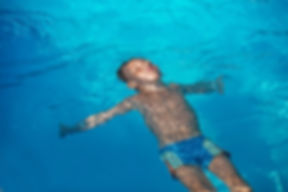 Afraid children in Ft. Myers learn to swim at Discovery Swim School.