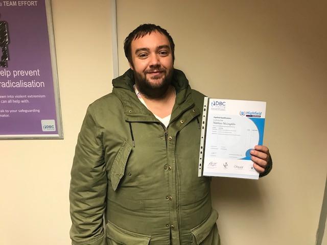 Matt Mcloughlin with his Customer Service certificate
