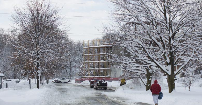 Student walking through snow on Rider campus