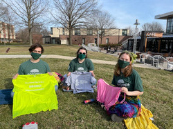 Sitting on the campus green, Eco Reps Emma, Dean & Ashlyn are ready to upcycle old tshirts at the 20